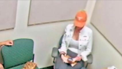 A photo of SanDee Jones being interrogated in a police station