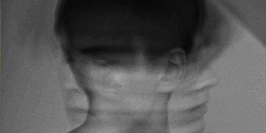 A black and white photo of a man shaking his head