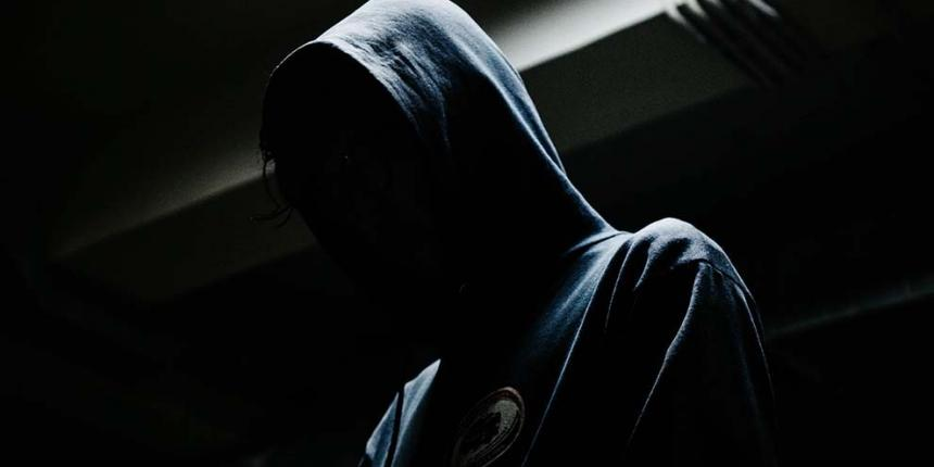 A photo of a hooded figure